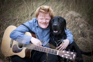 Phillip with his dog and guitar